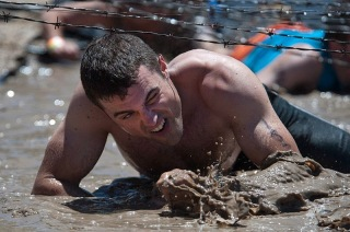 http://commons.wikimedia.org/wiki/File:Flickr_-_Official_U.S._Navy_Imagery_-_Sailor_crawls_through_the_mud_on_his_way_through_the_third_obstacle_of_the_Tough_Mudder_competition.jpg